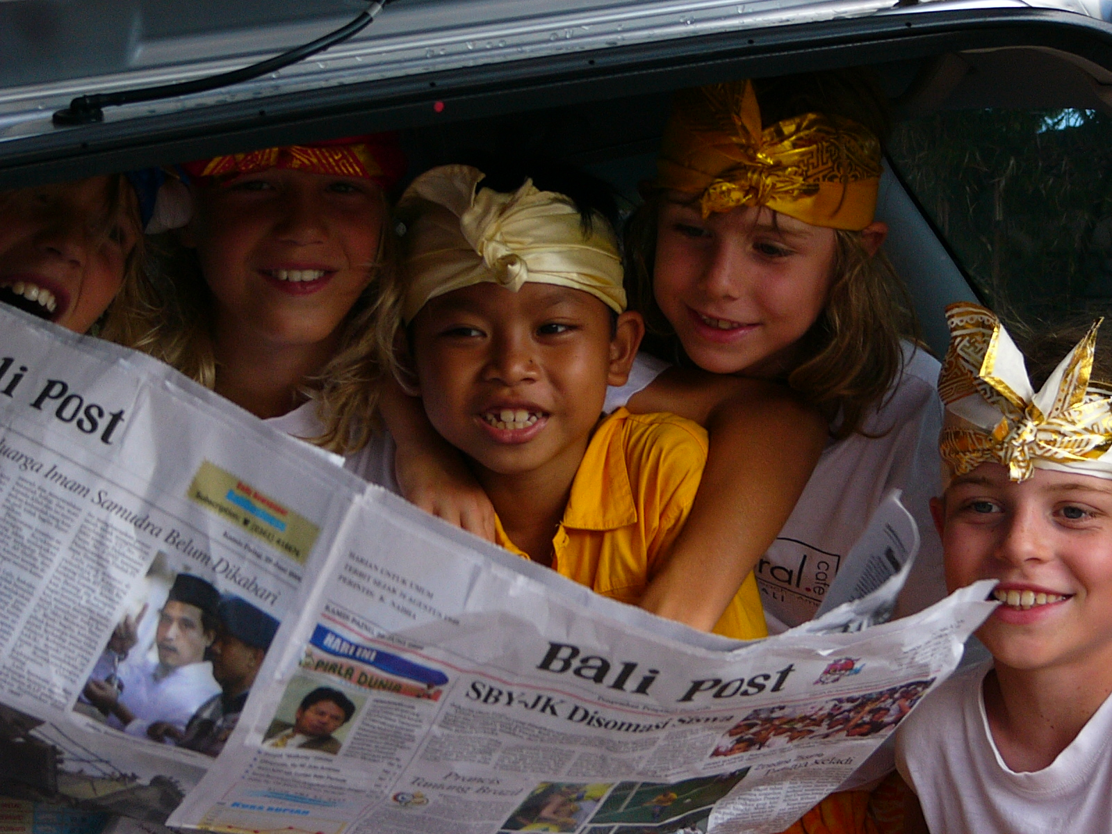 Kids reading newspaper